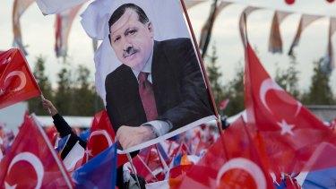A flag at an election rally bears the likeness of Recep Tayyip Erdogan.