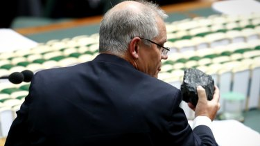 Treasurer Scott Morrison with a lump of coal during question time last year.