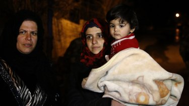 People wait to leave the besieged town of Madaya, north-west of Damascus, Syria.