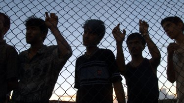 Asylum seekers on their first day in the compound on Nauru in 2012..