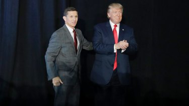 Michael Flynn introduces Donald Trump at a rally during the presidential campaign.