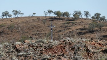 Locals have placed crosses to mark the death of the Menindee Lakes system.