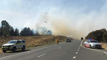 A grass fire is seen along the Hume Highway, north of Goulburn. The blaze prompted the closure of the road in both directions.