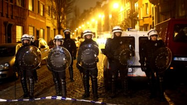 Police officers patrol after raids in which several people, including Paris attacks suspect Salah Abdeslam, were arrested on March 18 in the suburb of Molenbeek.