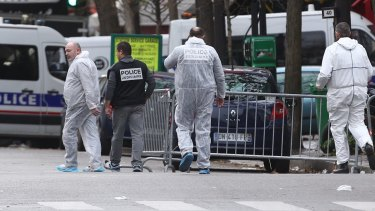 French police gathering evidence at the Bataclan theatre the morning after the terror attacks.