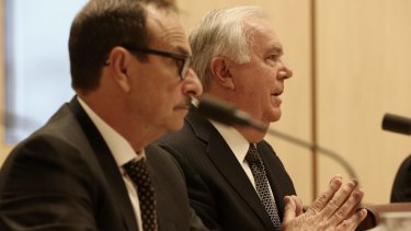 Michael Smith 7-Eleven chairman and Russell Withers 7-Eleven owner appeared before a Senate inquiry.