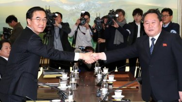 South Korean Unification Minister Cho Myoung-gyon, left, shakes hands with the head of North Korean delegation Ri Son-gwon before their meeting at the Panmunjom in the Demilitarized Zone in Paju, South Korea on Tuesday.