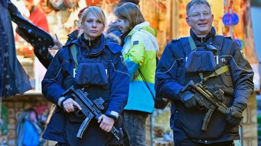 Police officers patrol at the Christmas market in Dortmund, Germany.