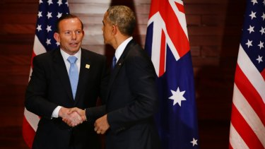 Prime Minister Tony Abbott and US President Barack Obama shake hands after a meeting at the US embassy in Beijing.