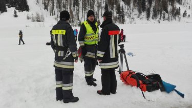 Rescuers prepare to board helicopters in Valle Aurina in the Italian Alps to reach the area on Monte Nevoso where six skiers have died in an avalanche.