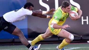 Jerry Tuwai of Fiji tries to stop Ed Jenkins.