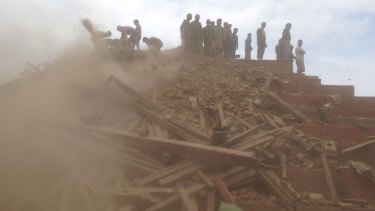 Volunteers help with rescue work at the site of a building collapse in Kathmandu in April.