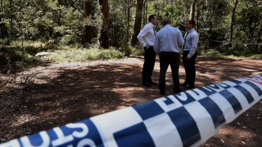 Detectives from the homicide squad at a crime scene in the Royal National Park.