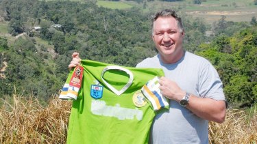 Steve Jackson with his premiership jersey at his home in Mackay.