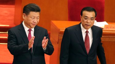 President Xi, standing beside Premier Li, is expected to consolidate his grip on power for the next five years.