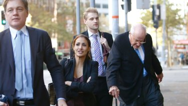 Rachelle Louise arrives at court on Wednesday with her legal team.