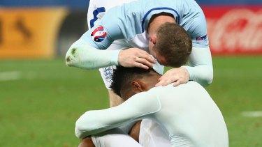 Feeling the pain: Daniel Sturridge is consoled by Wayne Rooney.