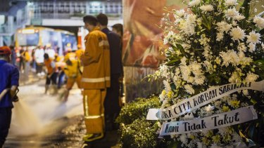 A bouquet of flowers placed in front of the explosion site in the centre of the Indonesian capital.