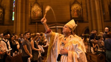 Archbishop of Sydney Anthony Fisher celebrates Easter Mass.