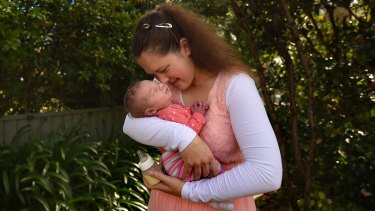 Shelley Parker, 32, holding her baby daughter Evelyn Parker at their home.