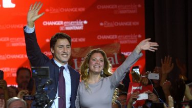 Justin Trudeau waves with his wife Sophie Gregoire in Montreal last year. The couple have now moved onto hand holding.