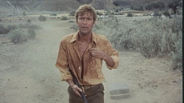 School teacher John Grant (Gary Bond) falls apart when faced with the vastness of the outback in the 1971 film, 'Wake in Fright'.