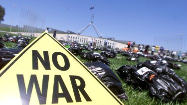 Protests against the Iraq war at Parliament House in Canberra in December 2002.