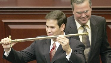 Happier days: Marco Rubio, left, with the ceremonial sword presented to him by his mentor (then-Florida Governor) Jeb Bush as Rubio was designated as the next Florida Speaker of the House. Bush and Rubio are now both fighting to be the Republican presidential nominee.