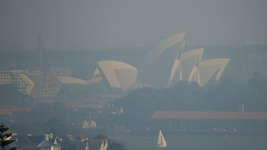 Sydney Opera house covered in haze from hazard reduction burns last May.