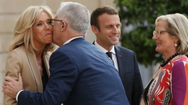 Malcolm Turnbull kisses Brigitte Macron, wife of French President Emmanuel Macron on arrival at the Palace.