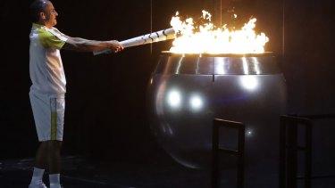 Vanderlei de Lima lights the Olympic flame.