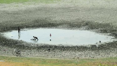 Indian fishermen catch fish in a shrunken pond in the village of Phaphamau on the outskirts of Allahabad.