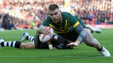 Josh Dugan scores Australia's second try against New Zealand at Anfield on Sunday.