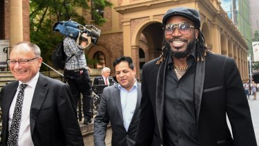 Chris Gayle leaves court after winning his defamation case against Fairfax Media.