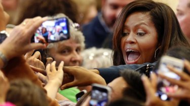 First lady Michelle Obama reaches out to shake hands during a campaign rally for Democratic presidential candidate Hillary Clinton.