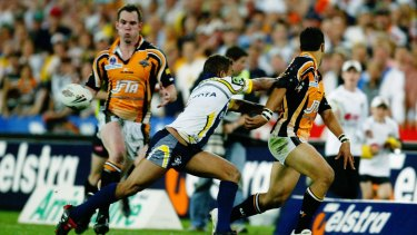 The moment: Benji Marshall flicks to Pat Richards for the match-sealing try in the 2005 grand final.