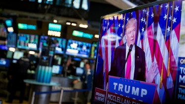 US President-elect Donald Trump is seen speaking on a television on the floor of the New York Stock Exchange (NYSE).