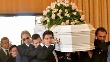 Grieving family and friends farewell Masa Vukotic\.
