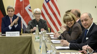 US Secretary of State John Kerry, left, US Under Secretary for Political Affairs Wendy Sherman (second left) and French Foreign Minister Laurent Fabius (right) at the start of a meeting in Lausanne on Saturday.