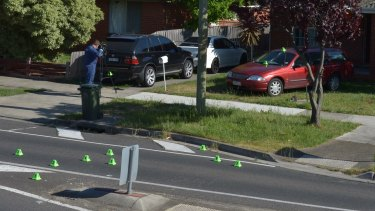 Police at the scene of a drive-by at a home in Thomastown where a 54-year-old-father was killed in a suspected case of mistaken identity.