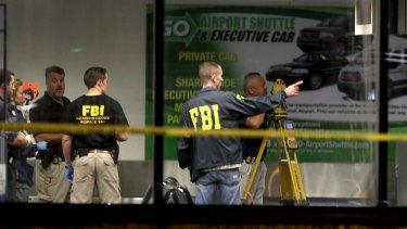 Investigators work in Terminal 2 at Fort Lauderdale-Hollywood International Airport.