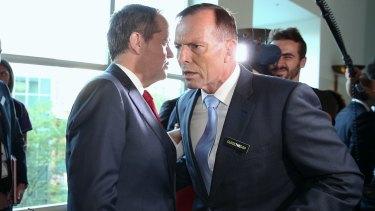 Opposition Leader Bill Shorten whispers to then prime minister Tony Abbott earlier this year.