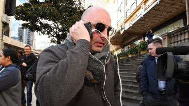 Woollahra property developer Daniel Hausman leaves court. He is charged with blackmail offences.