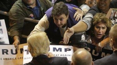 A sensation: Donald Trump signs autographs at the conclusion of a campaign event.