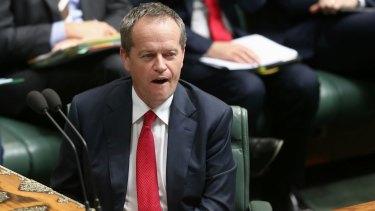 Opposition Leader Bill Shorten listens as Prime Minister Tony Abbott quotes <i>The Killing Season</i> during question time.