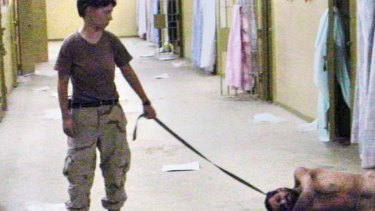 A US soldier with a naked detainee at the Abu Ghraib prison in Baghdad.