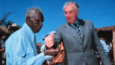 Then prime minister Gough Whitlam pours sand into the hand of Vincent Lingiari at an official ceremony to return traditional lands in the Northern Territory to the Gurindji people in 1975.