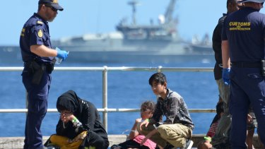 Asylum seekers arrive at Christmas Island.