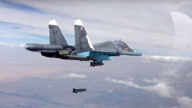 A bomb is released from a Russian Su-34 strike fighter in Syria.