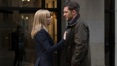 Michelle Williams and Tom Hardy in a scene from Venom.